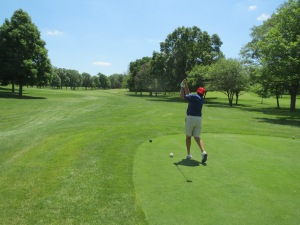 Norm Schulz teeing off on the par 4 16th
