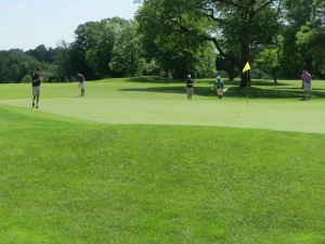 Micah Hyde's group on the par 4 13th