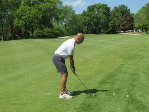 AM 620 WTMJ Sports Co-Anchor Greg Matzek setting up his approach to the 13th green