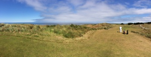 Panoramic view of the Pacific Ocean and the par three 15th hole at Bandon Dunes