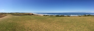 A panoramic view of the spectacular drivable par four 16th at Bandon Dunes