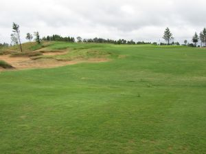 The par four 1st hole (325/315/290/250/230) from elevated tee boxes at Sand Valley Golf Resort