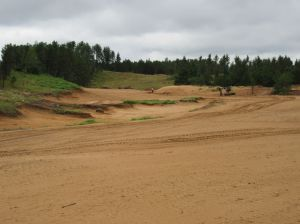 The long, meandering par five 7th hole (550/510/485/380/330) at Sand Valley Golf Resort
