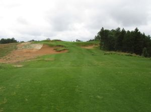 The short, uphill par three 8th hole (145/135/120/110/80) at Sand Valley Golf Resort
