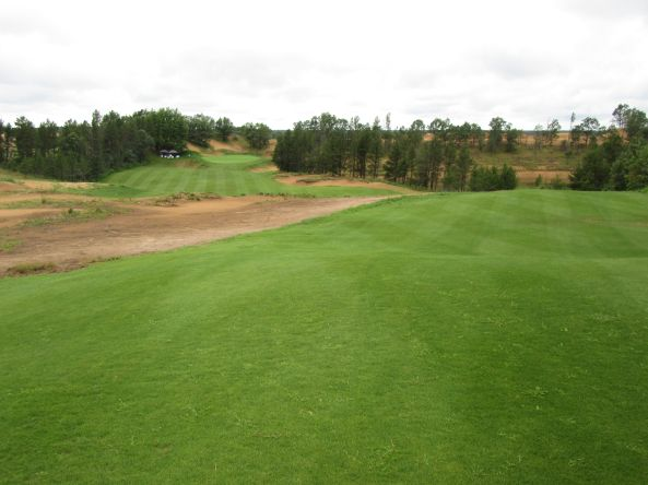 The drivable, downhill par four 9th hole (310/305/300/230/170) at Sand Valley Golf Resort