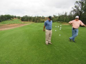 BR and Gary choosing teams for a ninth hole scramble at Sand Valley Golf Resort