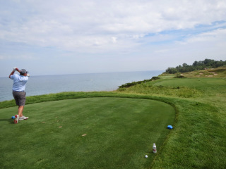 Photo of Kyle teeing off on the 17th of the Straits course at Whistling Straits