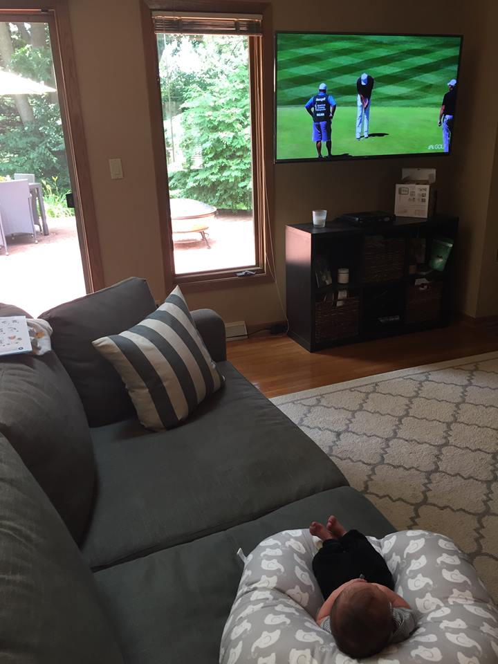 Charlie watching golf
