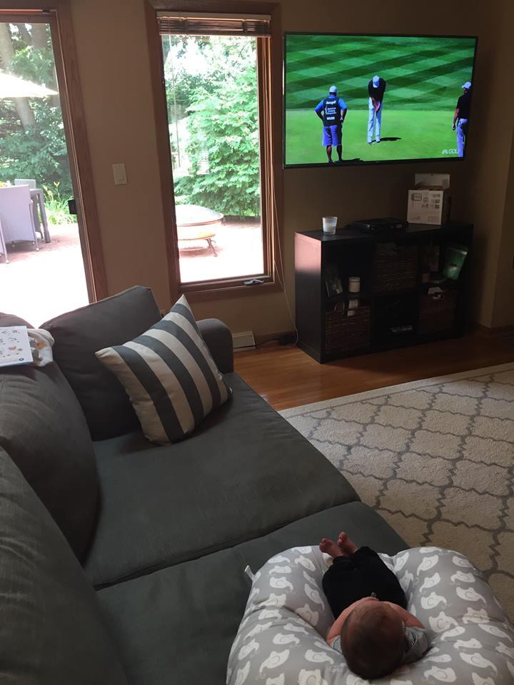 Charlie watching golf
